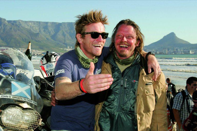 CAPE TOWN, SOUTH AFRICA - JULY 4: Ewan McGregor and Charley Boorman arrive at the end of their 'Long Way Down' trip, on August 4, 2007 in Cape Town, South Africa. United Nations Children's Fund (UNICEF) Goodwill Ambassador, Ewan McGregor and Charley Boorman, travelled over 15,000 miles on motorcycles from John O'Groats in Scotland to South Africa. Long Way Down is also being made into a TV series. In 2004 they conducted a similar trip, called 'Long Way Round' which saw them travel from London to New York. (Photo by Ron Gaunt/Getty Images for Long Way Down) *** Local Caption *** Ewan McGregor;Charley Boorman