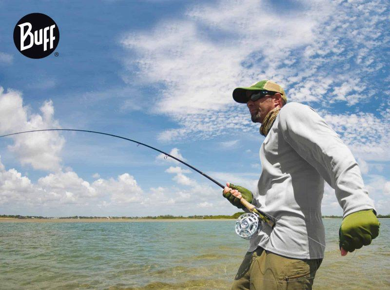 Side landscape shot of a fly fisherman on the water. He is wearing a long sleeved shirt and a High UV Buff® as scarf. The weather looks undecisive. It could be cool and warm within the hour. Source: buff.eu Copyright: Distributed for the promotion of the High UV Buff® in Fishing