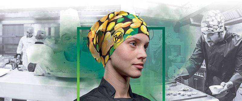 Photomontage banner for the SS2018 Pro Chef's Hat Collection. It shows a female chef wearing a bright yellow Buff® Pro Chef Hat in the foreground. In the background, you see different scenes of chefs working in a professional kitchen. Source: buff.eu