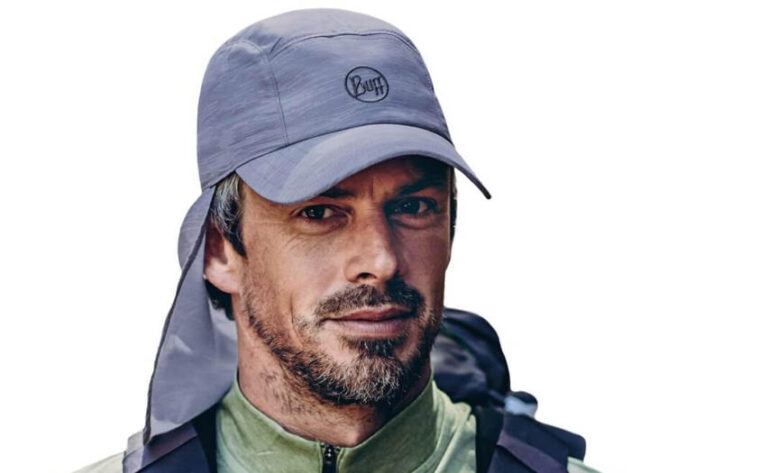 A studio photo of a man wearing a Buff® Bimini Cap. The man is wearing trekking gear and looks very fit. Source: buff.eu