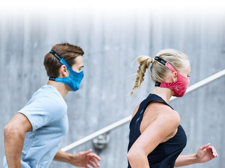 A couple running that are both wearing the new BUFF® filter face masks. Source: buff.eu