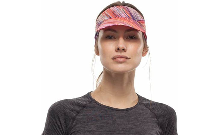 Studio photo of a woman wearing a BUFF® Pack Run Visor as a sun shade. Source: buff.eu