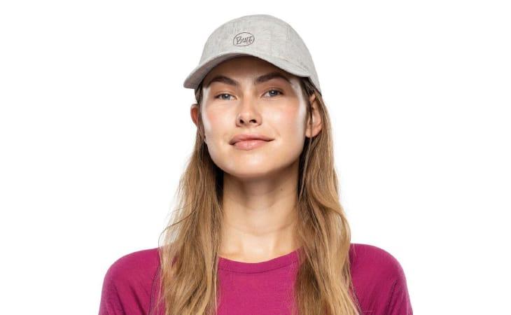Studio portrait photo of a woman wearing a BUFF® Air Trek Cap. Source: buff.eu